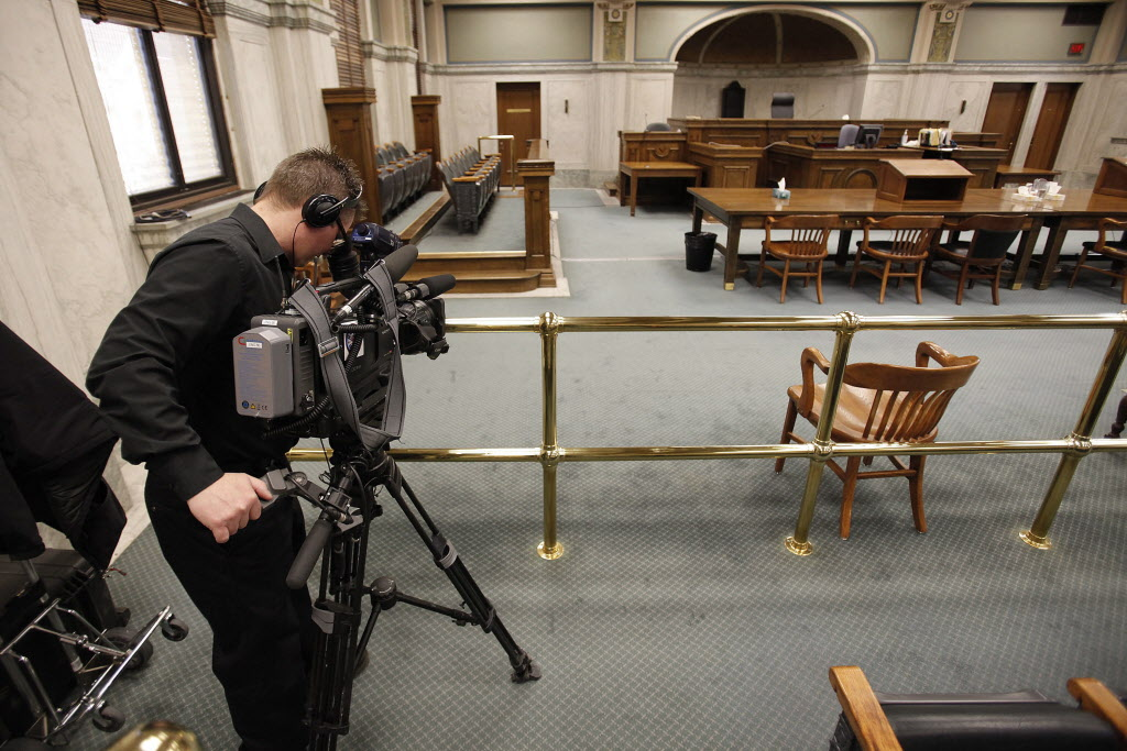 Jaison Empson, videographer for CBC, sets up his camera in the courtroom of the Court of Queens Bench Associate in preparation of Chief Justice Perlmutter pronouncing his decision on the second degree murder charge against Cassandra Knott in Winnipeg, Wednesday.