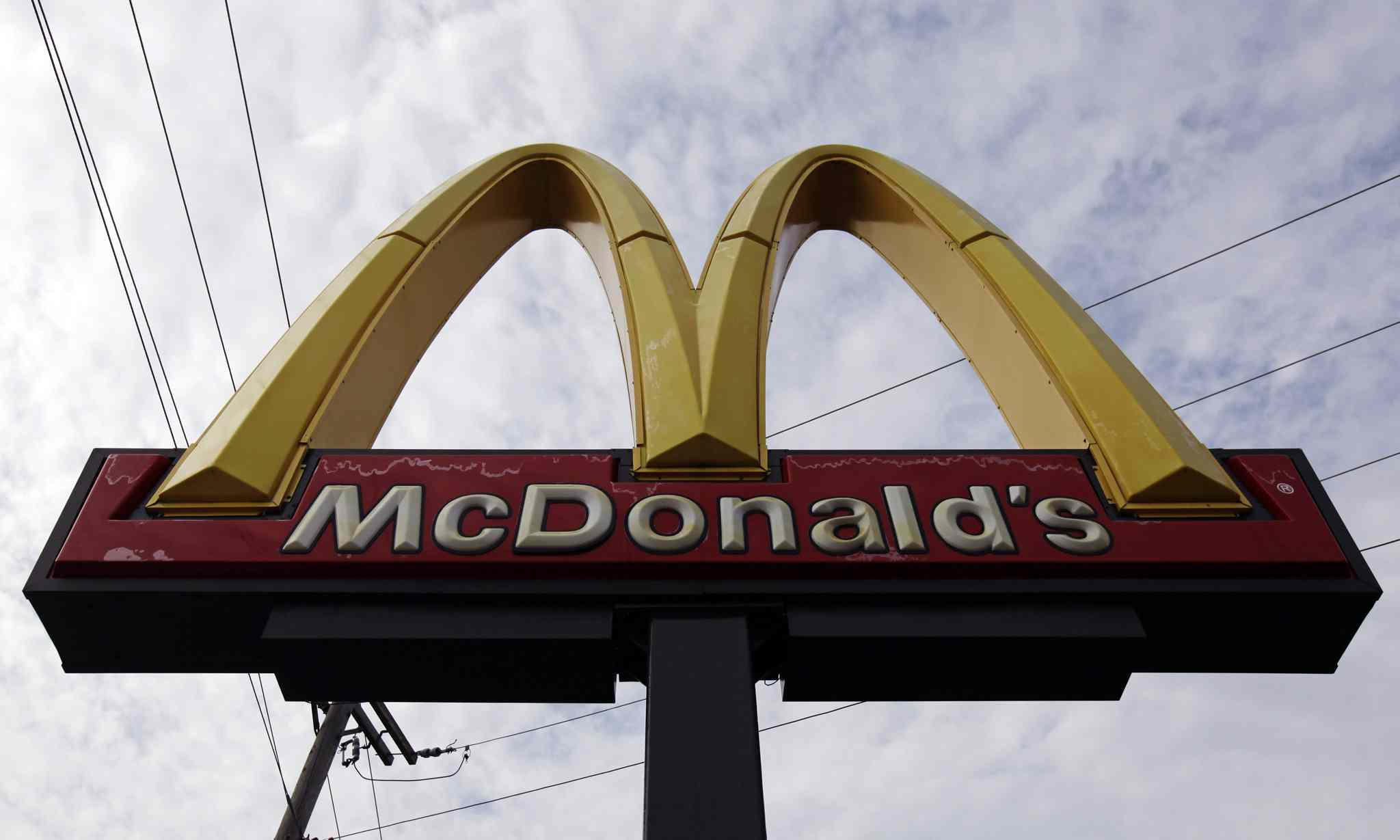 This Friday, Oct. 4, 2013 file photo shows a McDonald's restaurant sign at a McDonald's restaurant in Chicago. The first McDonald's in Vietnam opened earlier this month, bringing in 40,000 customers during its first two days of business.