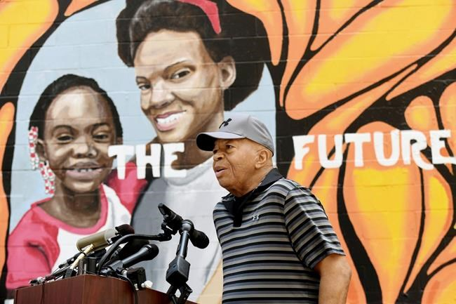 FILE - In this Aug. 3, 2019, Congressman Elijah Cummings speaks at the grand opening of the McCullough Street Nature Play Space in West Baltimore. Cummings, a sharecropper's son who rose to become the powerful chairman of a U.S. House committee that investigated President Donald Trump, died early Thursday, Oct. 17 of complications from longstanding health issues, his office said. He was 68. (Kim Hairston/The Baltimore Sun via AP, File)