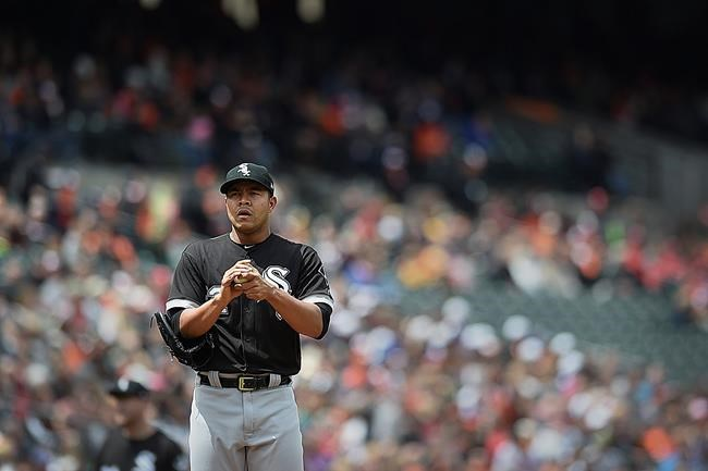 Chicago White Sox starting pitcher Jose Quintana pauses on the mound during the first inning of a baseball game against the Baltimore Orioles Sunday