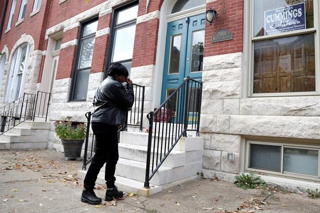 Bernice Mickens, who says she's a cousin of U.S. Rep. Elijah Cummings, D-Md., cries outside his house after finding out of his passing Thursday, Oct. 17, 2019, in Baltimore. Cummings, a sharecropper's son who rose to become the powerful chairman of one of the U.S. House committees leading an impeachment inquiry of President Donald Trump, died Thursday, Oct. 17, 2019, of complications from longstanding health issues. He was 68. (AP Photo/Julio Cortez)