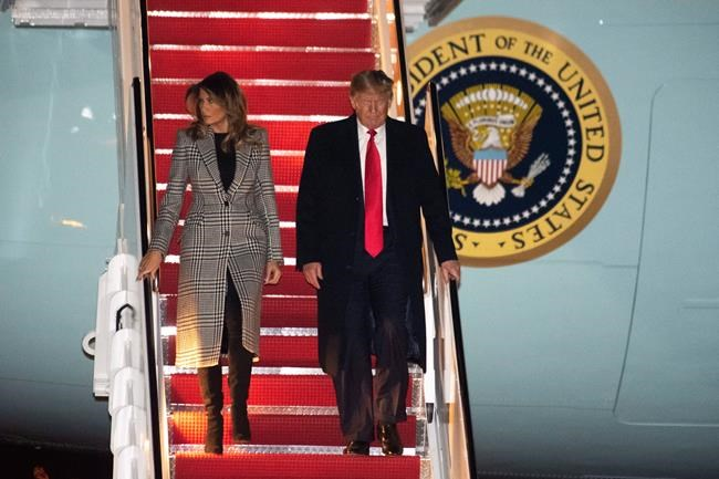 President Donald Trump and first lady Melania Trump arrive on Air Force One on Wednesday, Dec. 4, 2019, at Andrews Air Force Base, Md., following a trip to the NATO Summit in England. (AP Photo/Kevin Wolf)