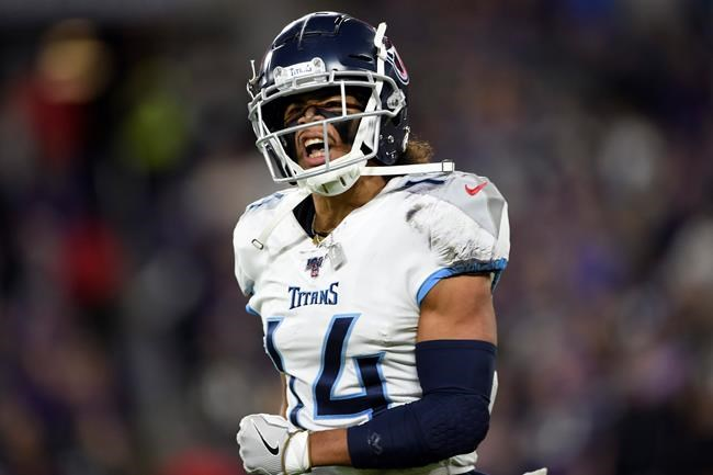 Tennessee Titans wide receiver Kalif Raymond (14) celebrates his touchdown during the first half an NFL divisional playoff football game against the Baltimore Ravens, Saturday, Jan. 11, 2020, in Baltimore. (AP Photo/Gail Burton)
