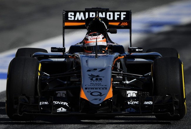Nico Hulkenberg of Germany and Force India steers his car during the 2015 Formula One testing at the Barcelona Catalunya racetrack in Montmelo, Spain, Saturday, Feb. 28, 2015. (AP Photo/Manu Fernandez)