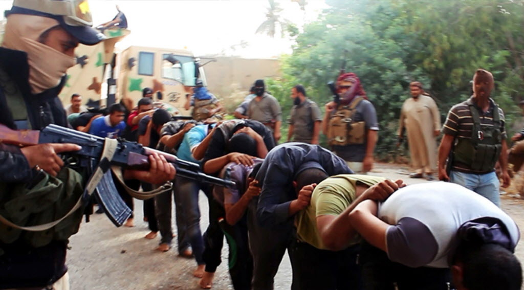 Image from a militant website appears to show insurgents from Islamic State of Iraq and Syria (ISIS) leading away Iraqi soldiers at a base in Tikrit, Iraq.