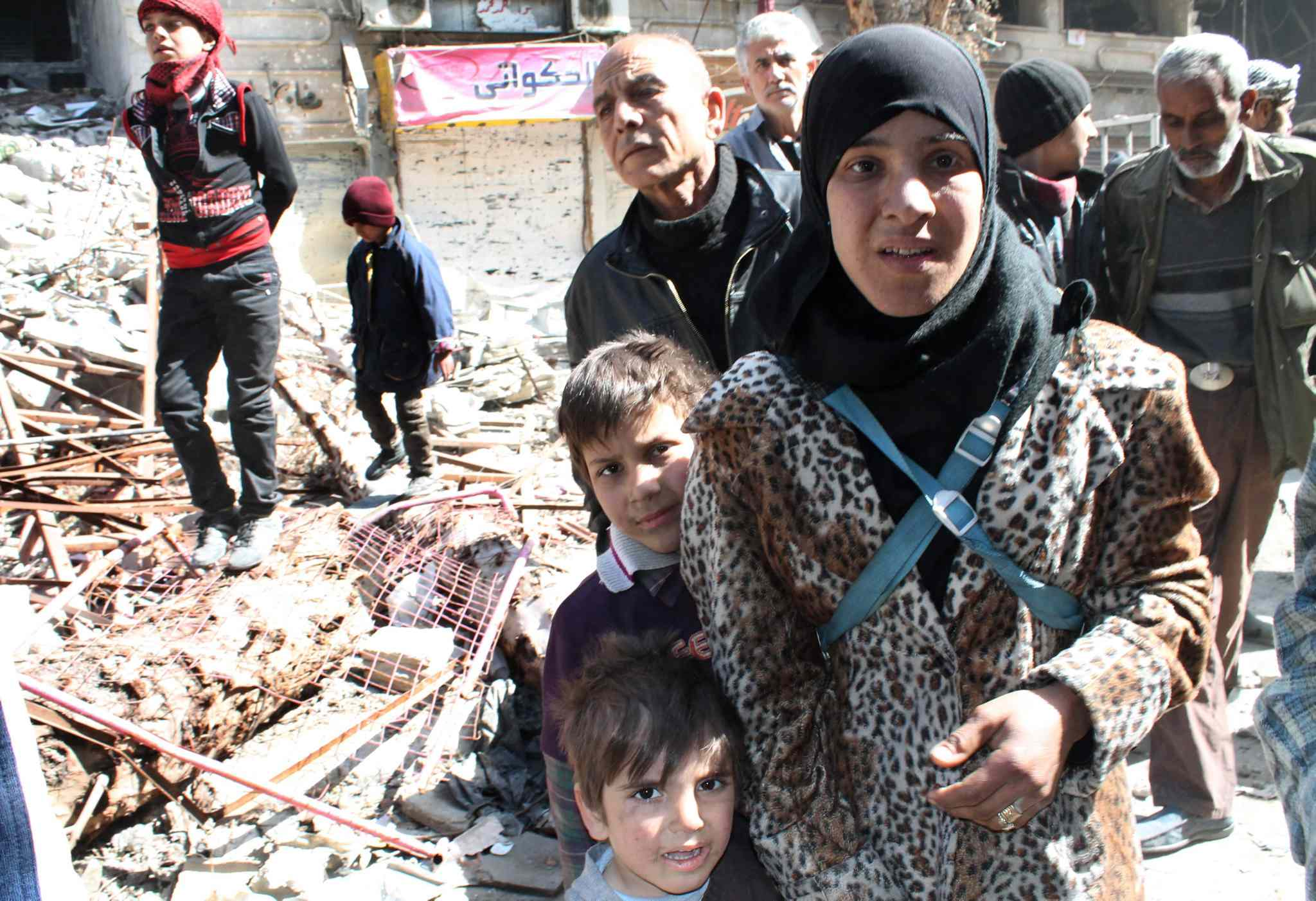Residents of the Yarmouk refugee camp wait for aid in Damascus, Syria.