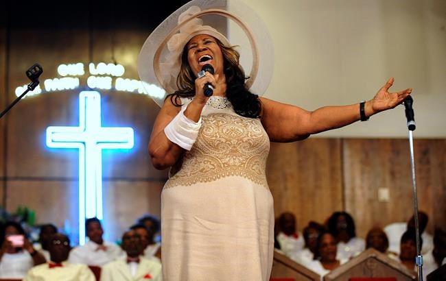 FILE - In this June 7, 2015 file photo, Aretha Franklin sings during a memorial service for her father and brother, Rev. C.L. and Rev. Cecil Franklin, at New Bethel Baptist Church where they were ministers, in Detroit. Franklin is still getting R.E.S.P.E.C.T. after death: The Queen of Soul received the Pulitzer Prize Special Citation honor Monday, April 15, 2019, becoming the first individual woman to earn a special citation prize since the honor was first awarded in 1930. Franklin, 76, died at her home in Detroit on Aug. 16, 2018. (Elizabeth Conley/The Detroit News via AP, File)