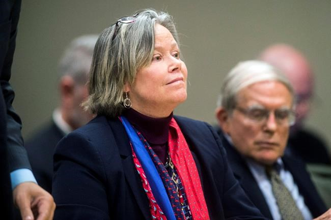 FILE - In this Dec. 7, 2018 file photo, former Michigan state medical executive Dr. Eden Wells appears in Flint, Mich. Wells, was charged during a video appearance before a Genesee County court Thursday, Jan. 14, 2021 in Flint, Mich., with involuntary manslaughter in deaths linked to the Flint water crisis. (Jake May/The Flint Journal via AP)
