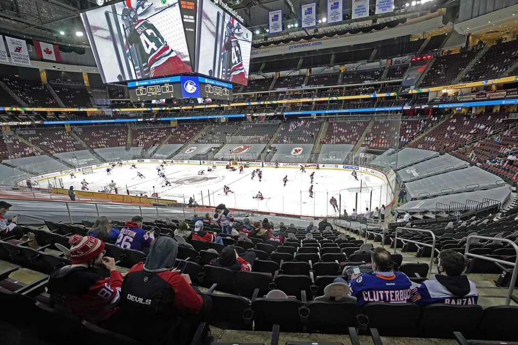 Fans sit in the stands watching warmup before the New Jersey Devils and the New York Islanders on March 2. It was the first time fans were allowed in the Prudential Center under New Jersey's new COVID-19 rules. (Kathy Willens / The Associated Press files)