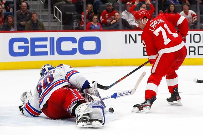 New York Rangers goaltender Henrik Lundqvist (30) stops a Detroit Red Wings center Dylan Larkin (71) shot in the second period of an NHL hockey game Saturday, Feb. 1, 2020, in Detroit. (AP Photo/Paul Sancya)