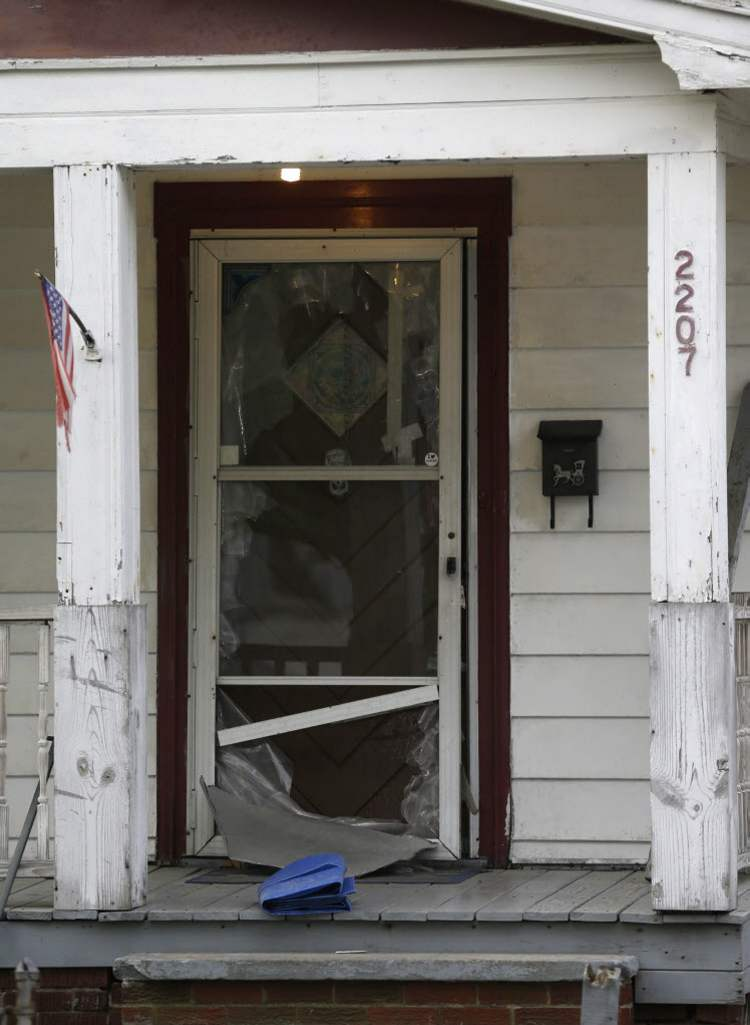 The front door of a house where three women escaped is shown Tuesday, May 7, 2013, in Cleveland.  (Tony Dejak / The Associated Press)