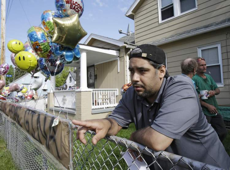 Ricardo DeJesus talks about his sister Gina at the family home Tuesday, May 7, 2013, in Cleveland. Police said Gina DeJesus and two other women who went missing separately about a decade ago were found in a house near downtown Cleveland Monday and likely had been tied up during years of captivity. Three brothers have been arrested. (AP Photo/Tony Dejak) (CP)