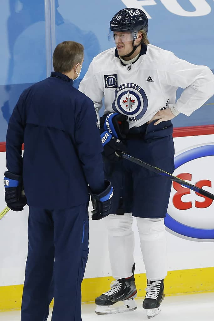 Winnipeg Jets sniper Patrik Laine, right, is expected to miss his third-straight game Thursday due to an upper body injury.