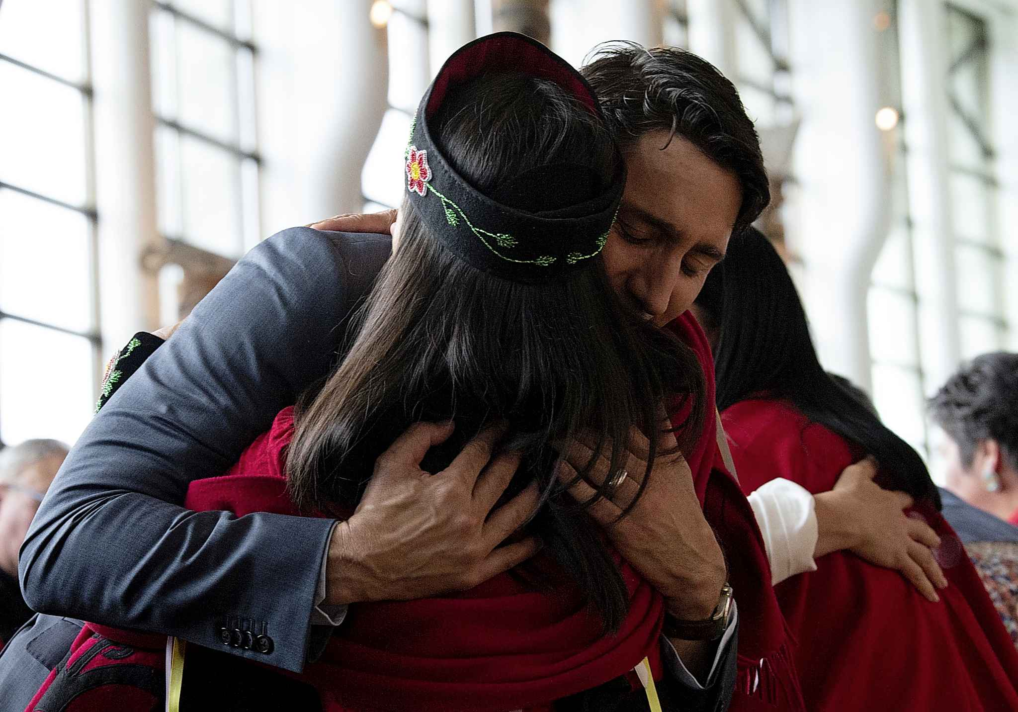 A woman is embraced by Canadian Prime Minister Justin Trudeau during ceremonies marking the release of the Missing and Murdered Indigenous Women report in Gatineau, Monday.