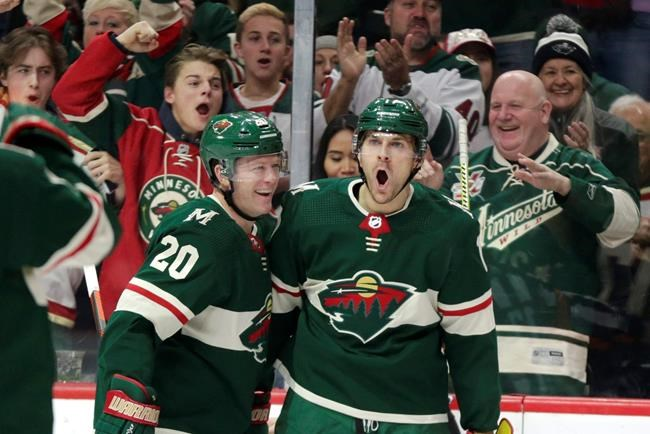 Minnesota Wild left wing Marcus Foligno (17) celebrates defenseman Ryan Suter (2) after scoring a goal against the Winnipeg Jets in the first period of an NHL hockey game Saturday, Jan. 4, 2020, in St. Paul, Minn. (AP Photo/Andy Clayton-King)