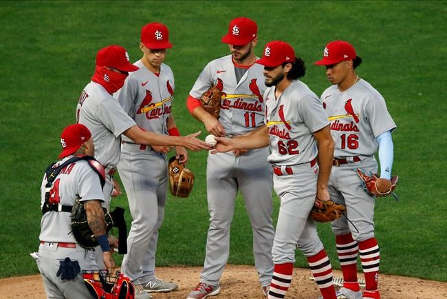 St. Louis Cardinals pitcher Daniel Ponce de Leon hands the ball over to manager Mike Shildt, left, after being pulled in the fifth inning of the team's baseball game against the Minnesota Twins on Wednesday, July 29, 2020, in Minneapolis. (AP Photo/Jim Mone)
