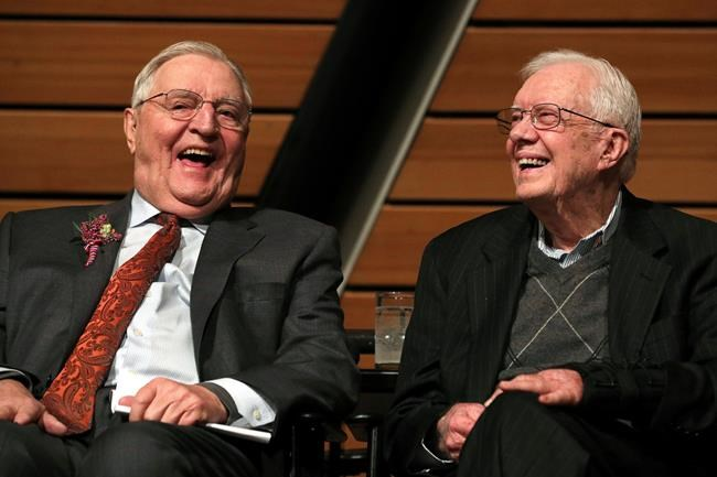 FILE - In this Saturday, Jan. 13, 2018, file photo, former Vice President Walter Mondale, left, sits onstage with former President Jimmy Carter during a celebration of Mondale's 90th birthday at the McNamara Alumni Center on the University of Minnesota's campus, in Minneapolis. (Anthony Souffle/Star Tribune via AP, File)