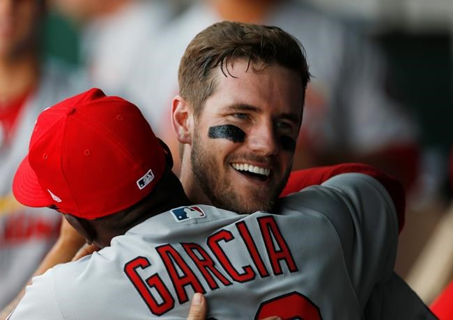 St. Louis Cardinals' Patrick Wisdom, right, is congratulated by Greg Garcia after scoring in his major league debut in the third inning of a baseball game against the Kansas City Royals at Kauffman Stadium in Kansas City, Mo., Sunday, Aug. 12, 2018. (AP Photo/Colin E. Braley)