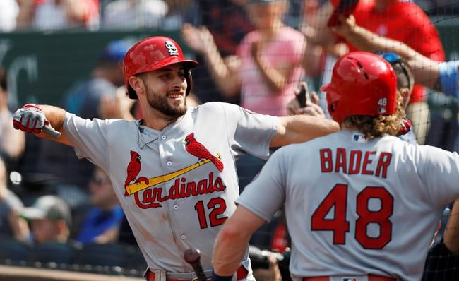 St. Louis Cardinals' Paul DeJong (12) celebrates with Harrison Bader (48) after hitting a two-run home run in the ninth inning of a baseball game against the Kansas City Royals at Kauffman Stadium in Kansas City, Mo., Sunday, Aug. 12, 2018. (AP Photo/Colin E. Braley)