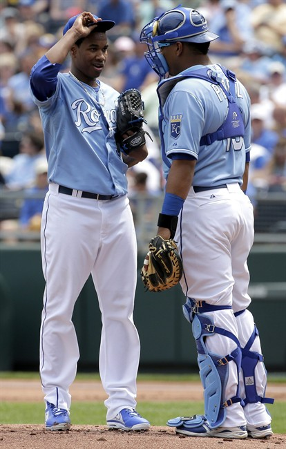 Kansas City Royals starting pitcher Yordano Ventura, left, talks with catcher Salvador Perez during the first inning of a baseball game against the Minnesota Twins, Sunday, April 20, 2014, at Kauffman Stadium in Kansas City, Mo. (AP Photo/Charlie Riedel)