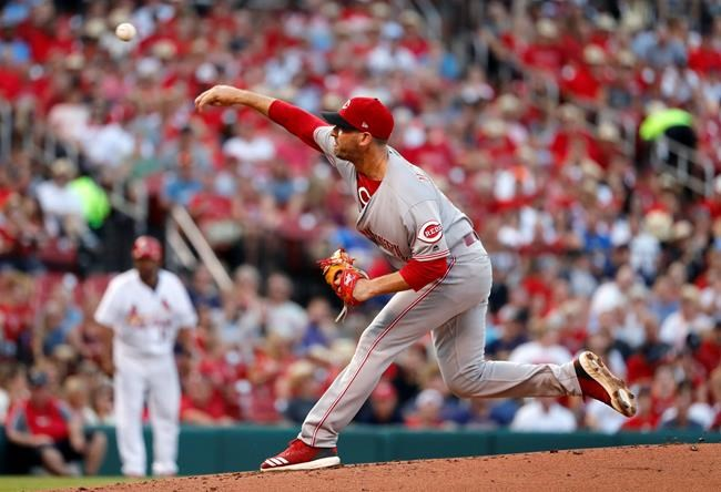 Cincinnati Reds starting pitcher Matt Harvey throws during the first inning of the team's baseball game against the St. Louis Cardinals on Friday, July 13, 2018, in St. Louis. (AP Photo/Jeff Roberson)