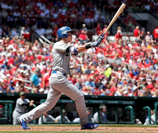 Hill bounces back to help pitch Dodgers past Cardinals