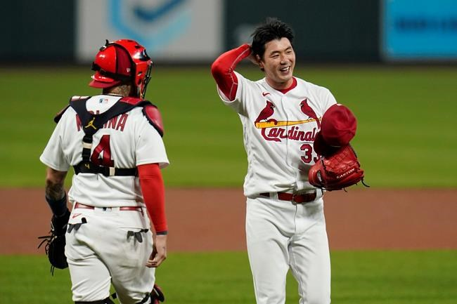 St. Louis Cardinals catcher Yadier Molina (4) walks out to the mound to talk with starting pitcher Kwang-Hyun Kim during the fifth inning of a baseball game against the Milwaukee Brewers Thursday, Sept. 24, 2020, in St. Louis. (AP Photo/Jeff Roberson)
