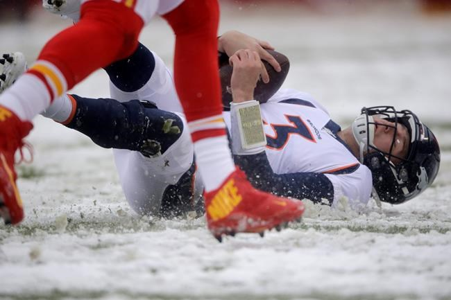 Denver Broncos quarterback Drew Lock (3) slides down in the snow after carrying the ball for a first down, during the first half of an NFL football game against the Kansas City Chiefs in Kansas City, Mo., Sunday, Dec. 15, 2019. (AP Photo/Charlie Riedel)