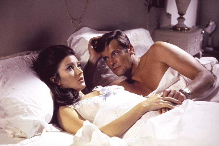 Jane Seymour, left, and Roger Moore, in the James Bond 1973 film, Live and Let Die. Initially, Bond girls were part of the esthetic of the series. They had more transient roles.  (CP)