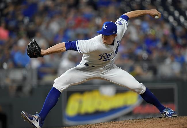 Kansas City Royals relief pitcher Tim Hill throws against the Minnesota Twins during the seventh inning of a baseball game in Kansas City, Mo., Saturday, Sept. 15, 2018. (AP Photo/Reed Hoffmann)
