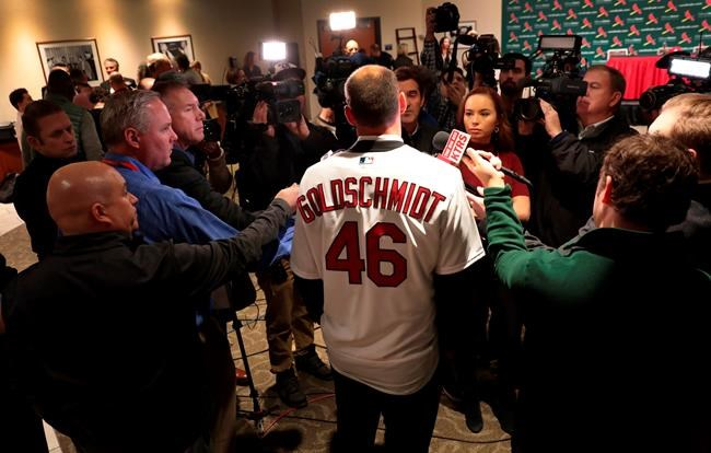 St. Louis Cardinals' newest player Paul Goldschmidt speaks with reporters after his introduction at a baseball news conference, Friday, Dec. 7, 2018, at Busch Stadium in St. Louis. The six-time All-Star was acquired from Arizona this week and will earn $14.5 million in the final season of a seven-year deal that will pay $46 million, including a $1 million assignment bonus for the trade. (Robert Cohen/St. Louis Post-Dispatch via AP)
