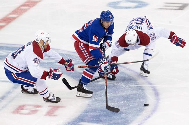 New York Rangers center Ryan Strome (16) skates between Montreal Canadiens right wing Joel Armia (40) and left wing Artturi Lehkonen (62) during the third period of an NHL hockey game Friday, Dec. 6, 2019, at Madison Square Garden in New York. The Canadiens won 2-1. (AP Photo/Mary Altaffer)