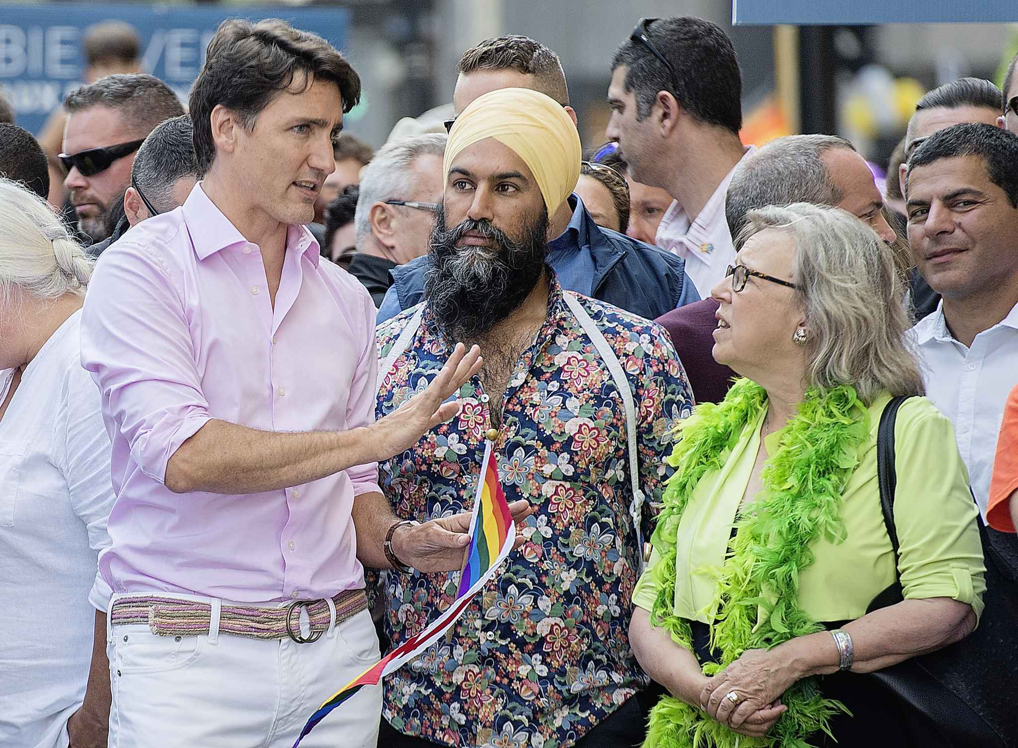 Prime Minister Justin Trudeau (left) attends the annual pride parade with NDP leader Jagmeet Singh and Green Party leader Elizabeth May in Montreal in August. (Graham Hughes / The Canadian Press files)