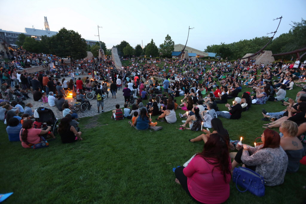 People attend a vigil for Tina Fontaine and Faron Hall at the Oodena Circle at The Forks. (Trevor Hagan / The Canadian Press)