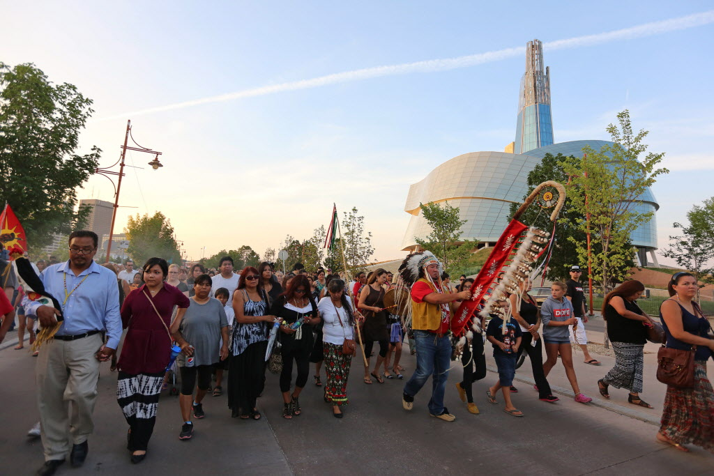 People walk from the Alexander Docks to The Forks.