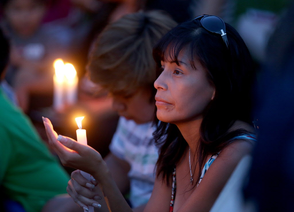 People attend a vigil for Tina Fontaine and Faron Hall at the Oodena Circle at The Forks.