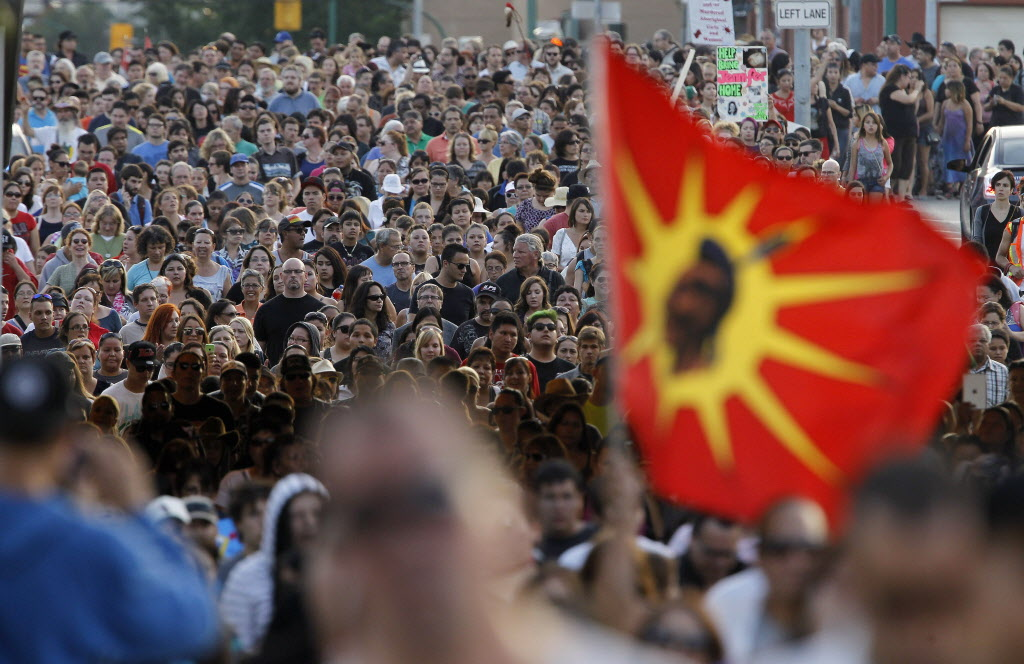 People attend a vigil for Tina Fontaine in Winnipeg in August 2014.