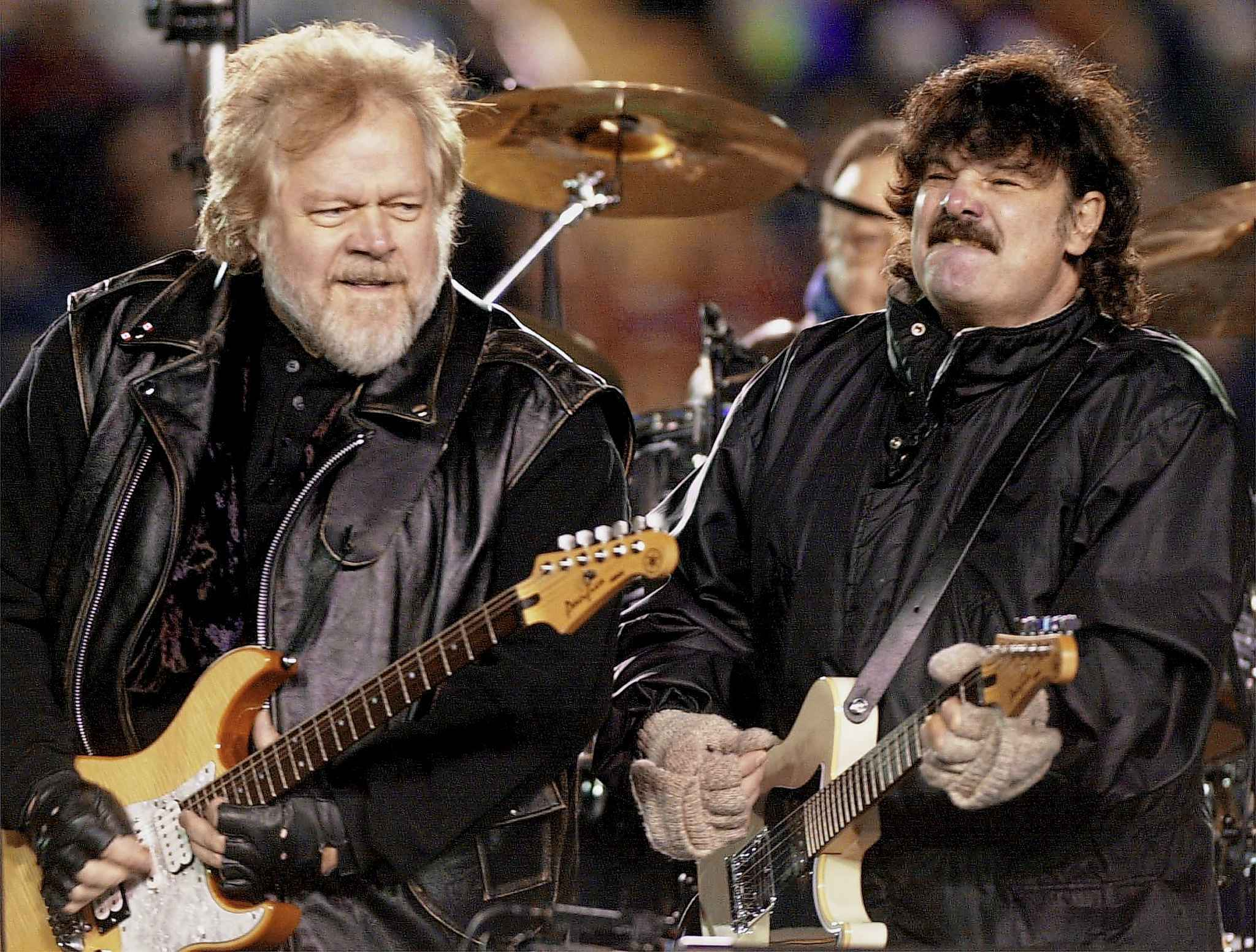 Randy Bachman and Burton Cummings perform during the halftime show at the 88th Grey Cup game in Calgary on November 26, 2000. (Aaron Harris / The Canadian Press files)