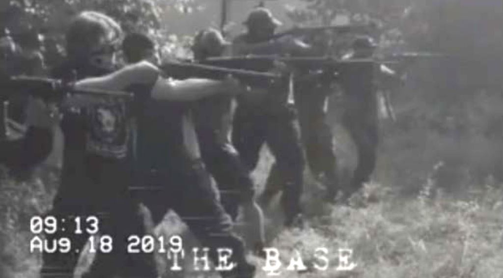 A photograph from a Base training camp. (U.S. Attorney via The Associated Press)    United States District Court for the District of Maryland  - filed January 21, 2020    - Patrik Mathews  - The Base - white supremacist organization    From document:  Later in August 2019, (Brian Mark) Lemley and (William Garfield) Bilbrough attended another Base training camp in a different state. The photographs below were taken at that separate training camp. In the second photograph, Bilbrough is standing second from the left while firing a long gun.    - for Ryan Thorpe story / Winnipeg Free Press