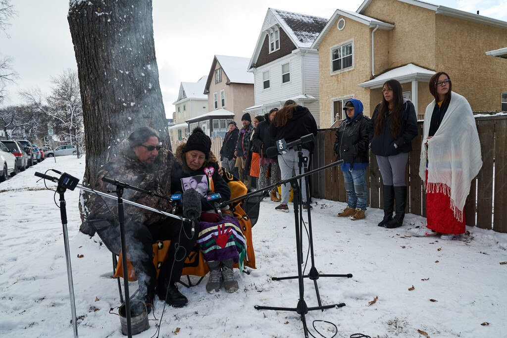 Family and friends of 11-month-old Anthony Dethmers and his mother Jennifer Dethmers speak at a press conference on Wednesday. (David Lipnowski / The Canadian Press files)