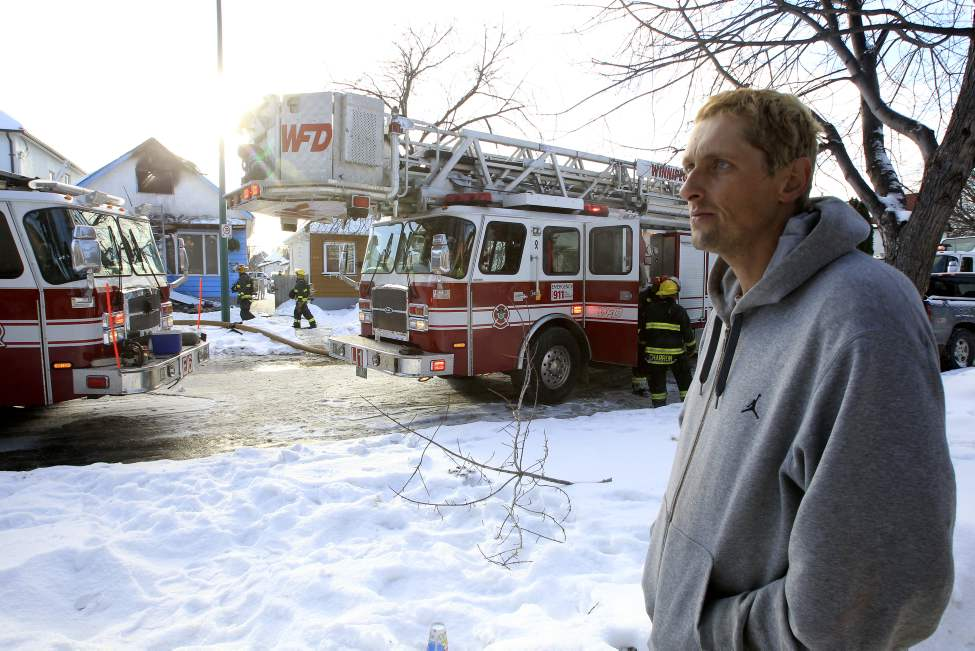 Jonathan Williams, 39, surveys the damage to the house on Flora Avenue he shared with his ten kids. The house was destroyed by fire Saturday afternoon. January 08, 2011