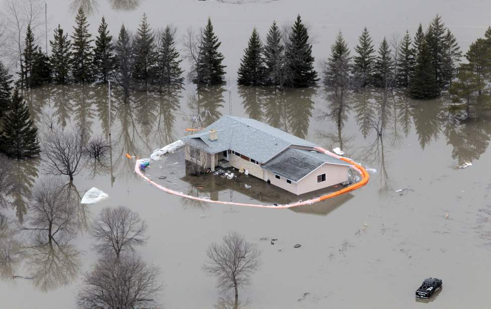The Red River flyover north of Winnipeg during the 2011 Flood. A house with a breached sandbag dike sits flooded off Breezy Point Rd. north of Selkirk. April 08, 2011