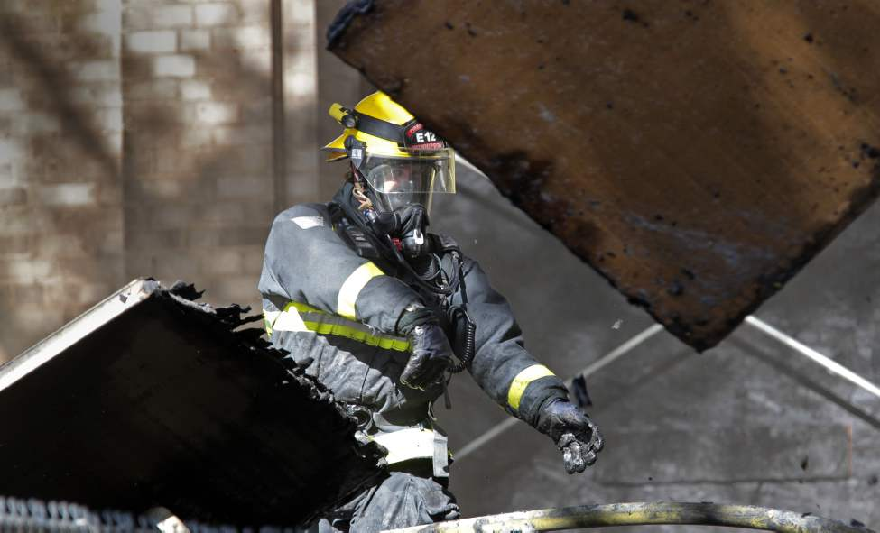 Laura Secord school in the Wolseley area of Winnipeg was evacuated this afternoon due to a fire. A fireman throws some of the damaged insulation that was being installed at the school while looking for hotspots in the debris. October 05, 2011