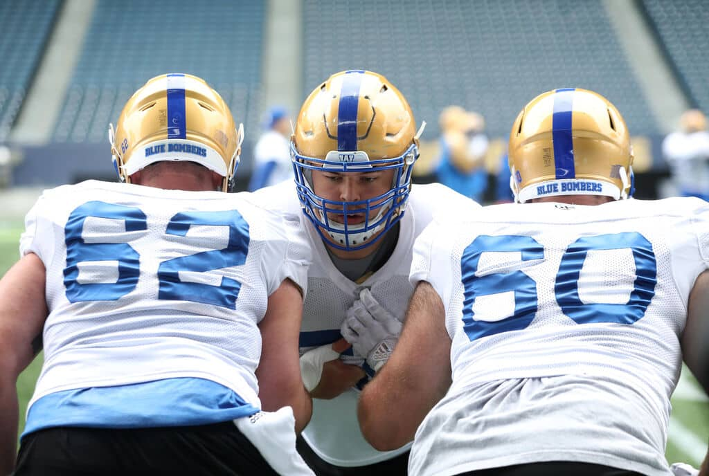 Bombers' offensive lineman Michael Couture, centre, is expected to anchor the team's front five.