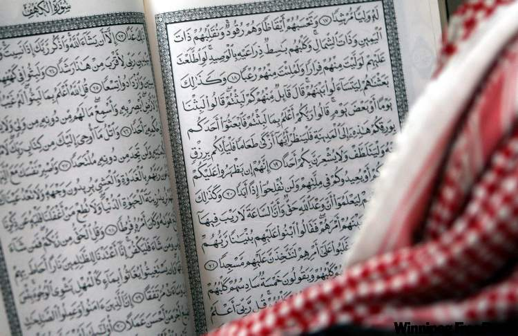 A Palestinian Muslim man reads from the Qu'ran, at a mosque during  in the West Bank city of Jenin.