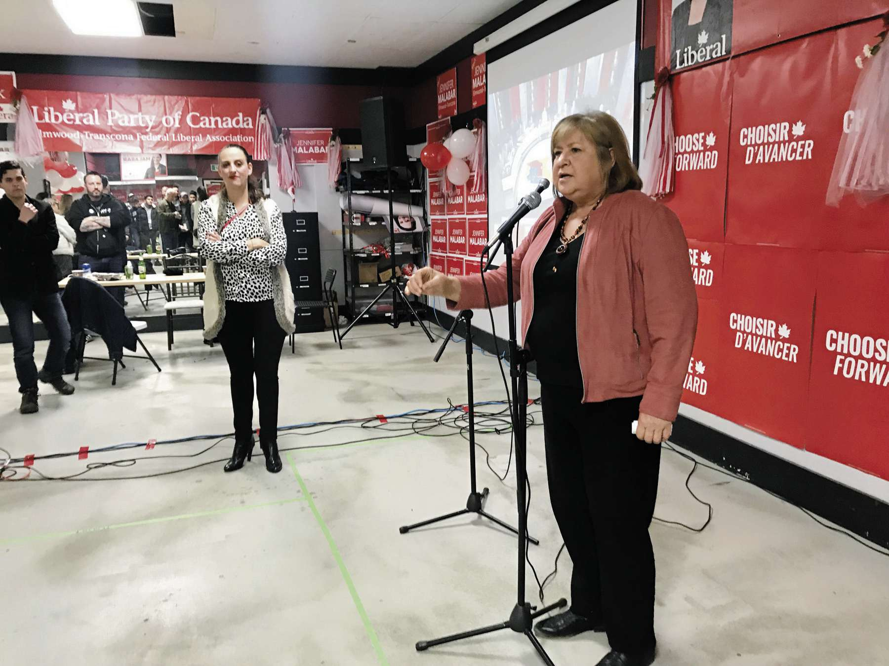 LIberal MaryAnn Mihychuk addresses supporters at her campaign headquarters after conceding defeat to Conservative Raquel Dancho in the election for Kildonan-St. Paul, while Jennifer Malabar, Liberal candidate for Elmwood-Transcona, looks on.