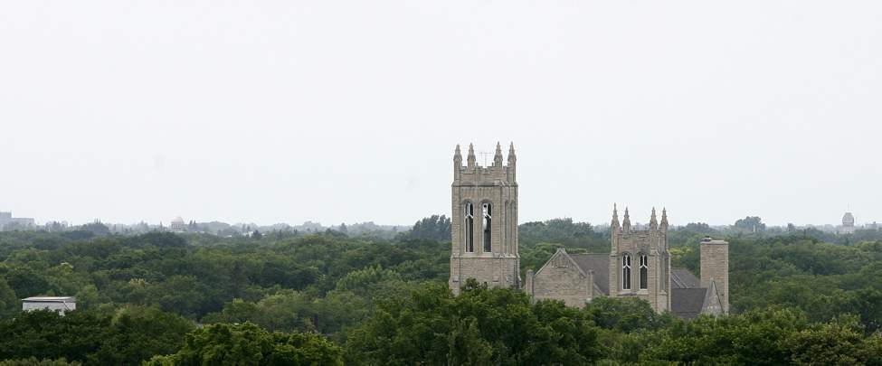 The Westminster United Church rises above the tree canopy as seen from the roof of the Manitoba Legislature. Friday, July 13, 2012. (MIKE DEAL / WINNIPEG FREE PRESS)