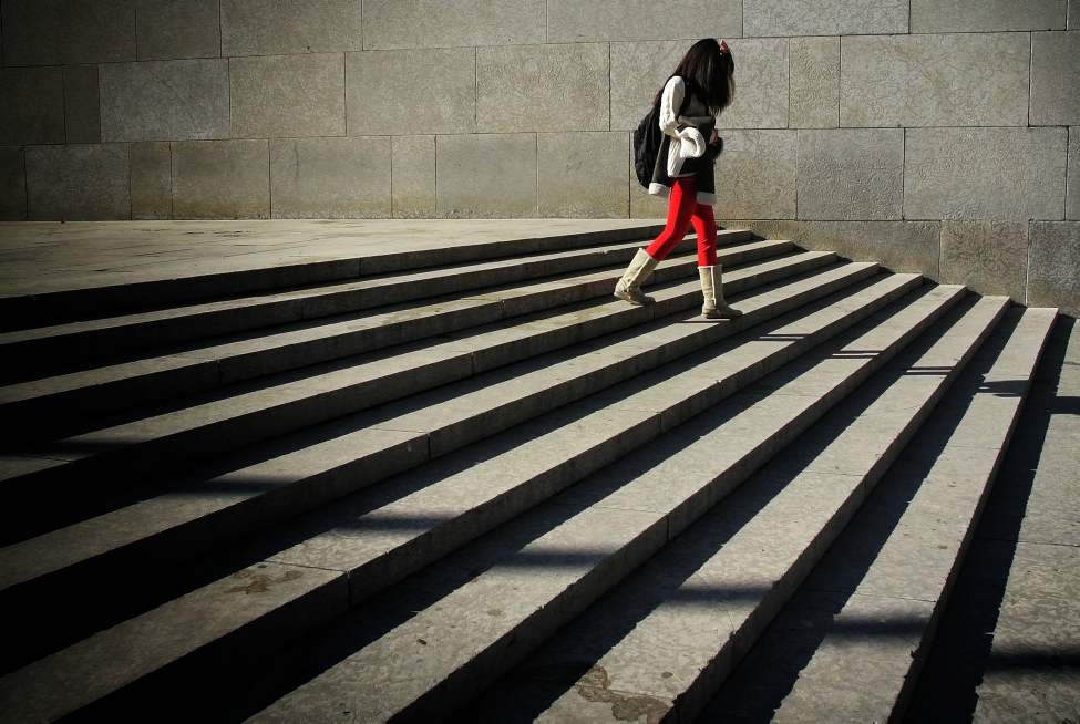 A pedestrian takes the stairs outside the Winnipeg Art Gallery.   Monday, October 01, 2012.  (MIKE DEAL / WINNIPEG FREE PRESS)