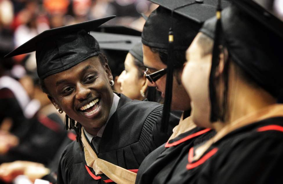 Franck Ndayubashe laughs with his fellow graduates in Bachelors of Business Administration during convocation at the University of Winnipeg.   Sunday, October 21, 2012.  (MIKE DEAL / WINNIPEG FREE PRESS)