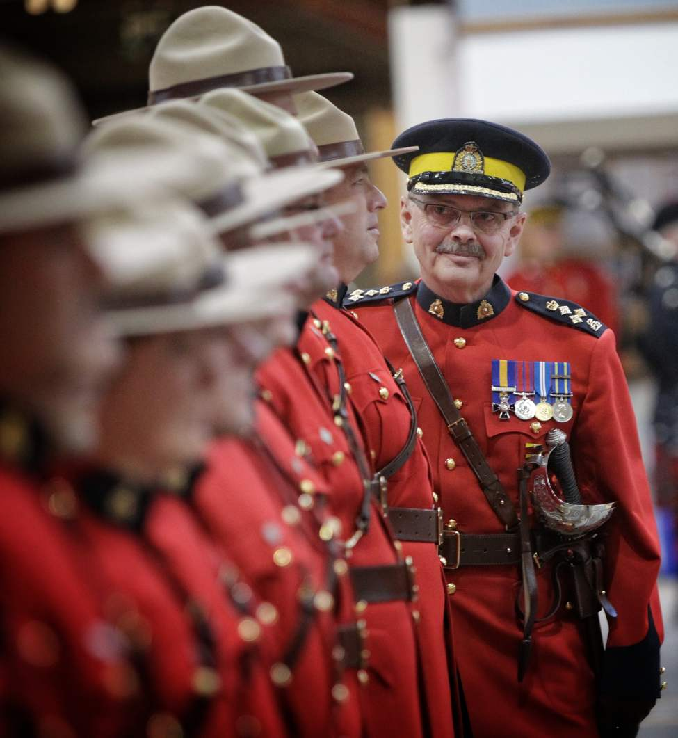 Assistant Commissioner Bill Robinson reviews the troops for the last time during the Change of Command Ceremony at the Minto Armouries. Assistant Commissioner Kevin Brosseau replaced Robinson as RCMP